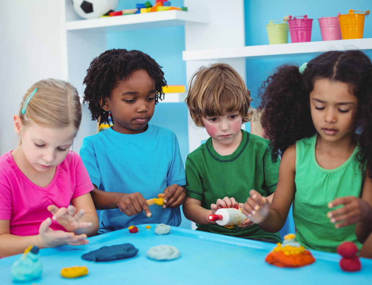 four children playing with playdoh